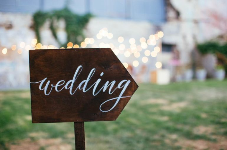 Wedding and party place decoration with wooden sign